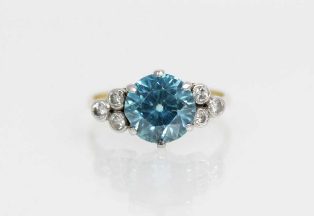 A zircon and diamond ring, the central round mixed cut blue zircon (measuring 8.65mm diameter), - Image 6 of 8