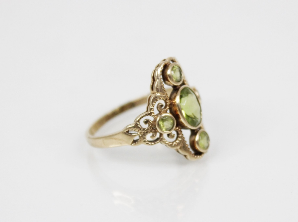 A 9ct gold peridot set dress ring, the central oval mixed cut peridot (measuring 7mm x 6mm), - Image 3 of 5