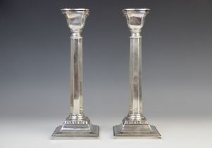 A pair of George V silver candlesticks, marks for 'M.S', London 1933, each with faceted stems and