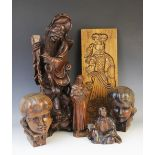 A collection of European and Eastern carvings, 20th century, to include a pair of Flemish masks of