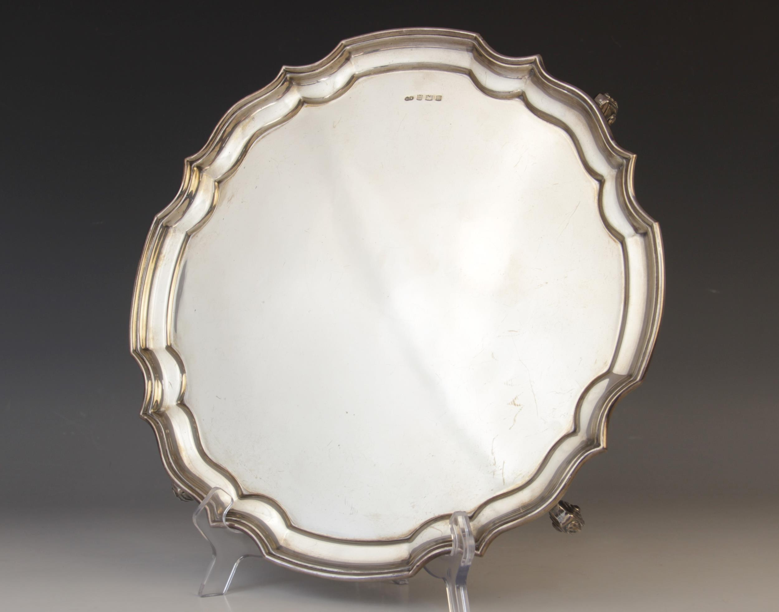 A silver salver by Sanders & McKenzie, Birmingham 1969, of circular form with pie-crust border on