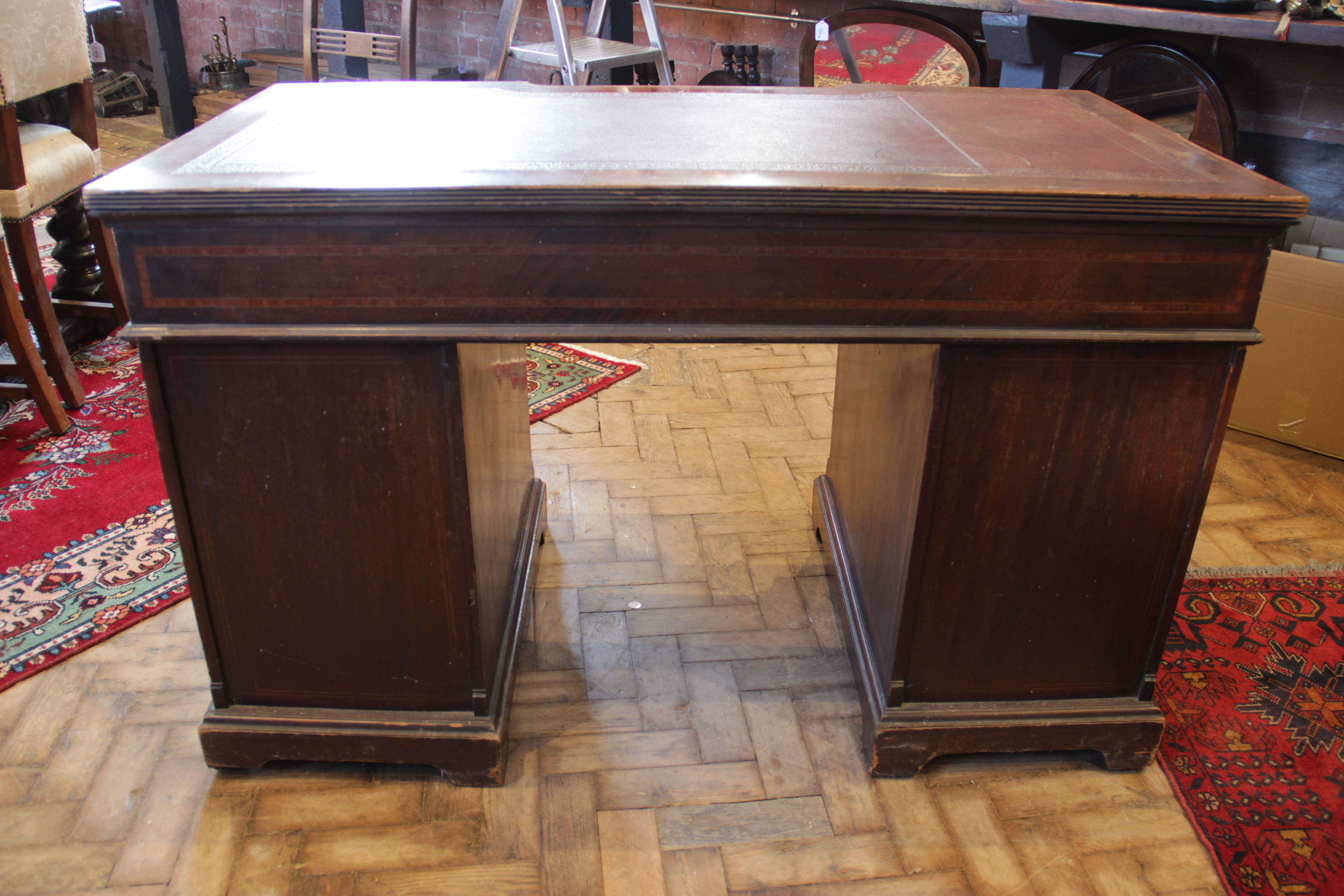A late 19th century inlaid mahogany twin pedestal writing desk, the inverted breakfront top with a - Image 5 of 7
