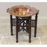 A 19th century copper brazier bowl, applied with brass side swing handles, upon an associated chip