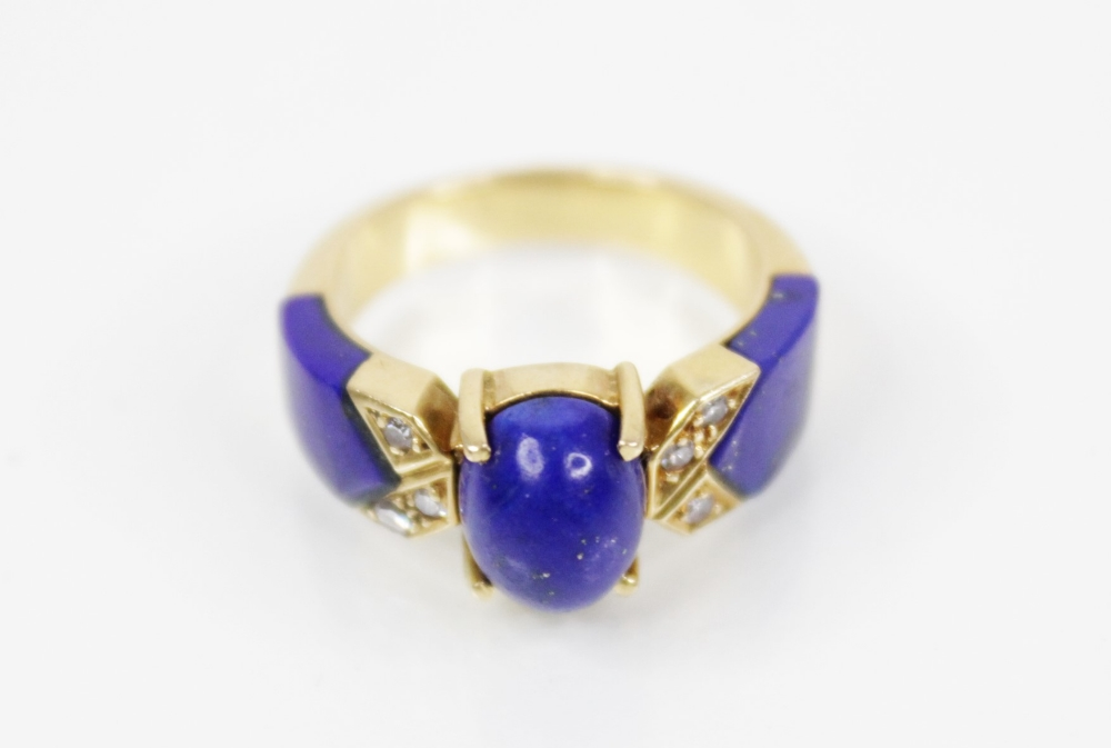 A lapis lazuli and diamond set dress ring, designed as a central polished oval lapis lazuli cabochon - Image 2 of 6
