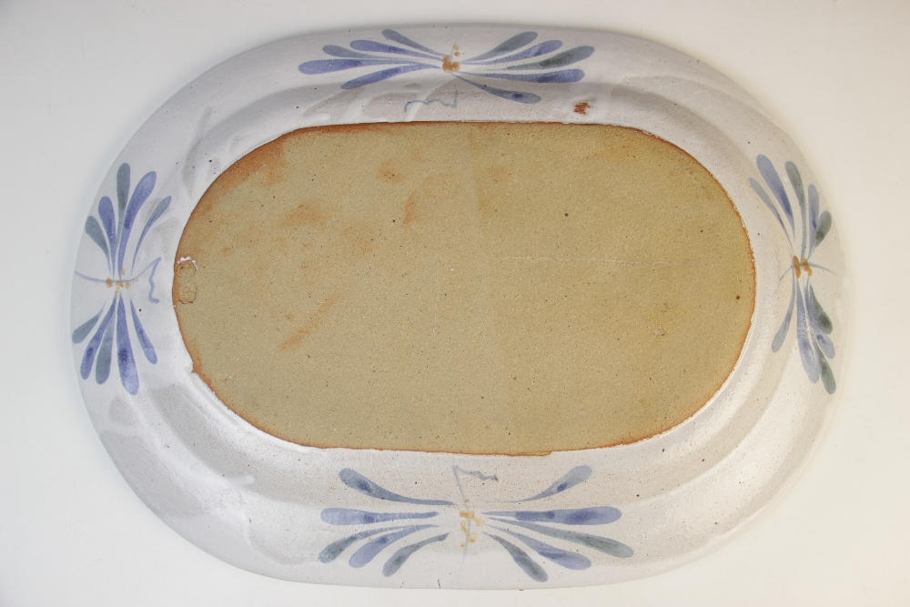A Cooper Pottery studio pottery fish plate, of oval form, applied with a central blue fish on a - Image 2 of 3