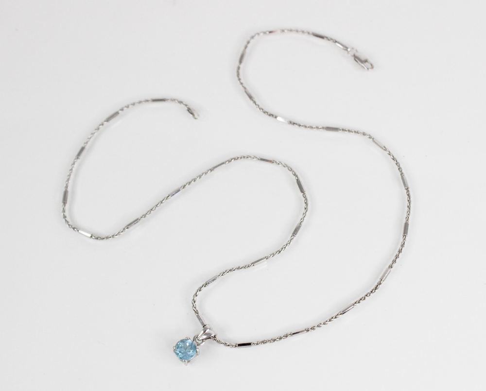 A blue topaz pendant on 18ct gold chain, the central round mixed cut blue topaz (measuring 6mm