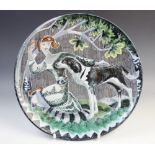 A Swedish Tilgmans Keramik studio pottery charger or wall plaque titled 'VANNER', mid 20th