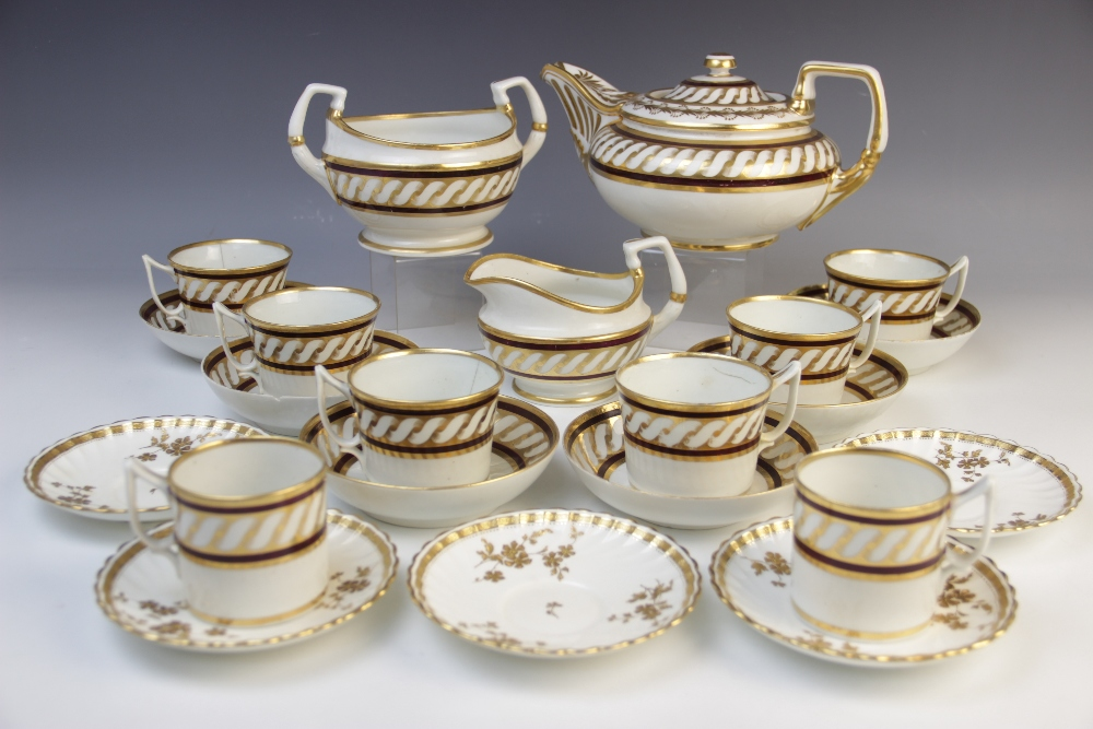 A Derby porcelain part tea service, early 19th century, comprising: a teapot and cover, a milk