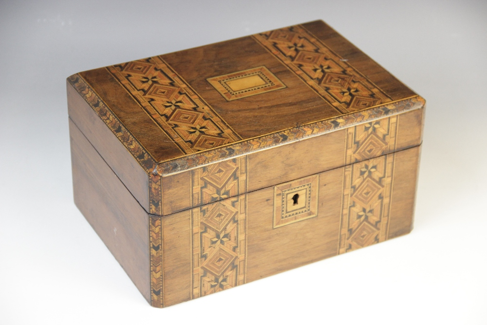 A Victorian walnut and parquetry banded sewing box, the hinged cover opening to a