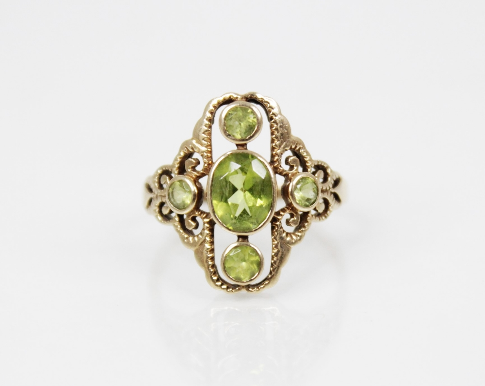 A 9ct gold peridot set dress ring, the central oval mixed cut peridot (measuring 7mm x 6mm), - Image 2 of 5