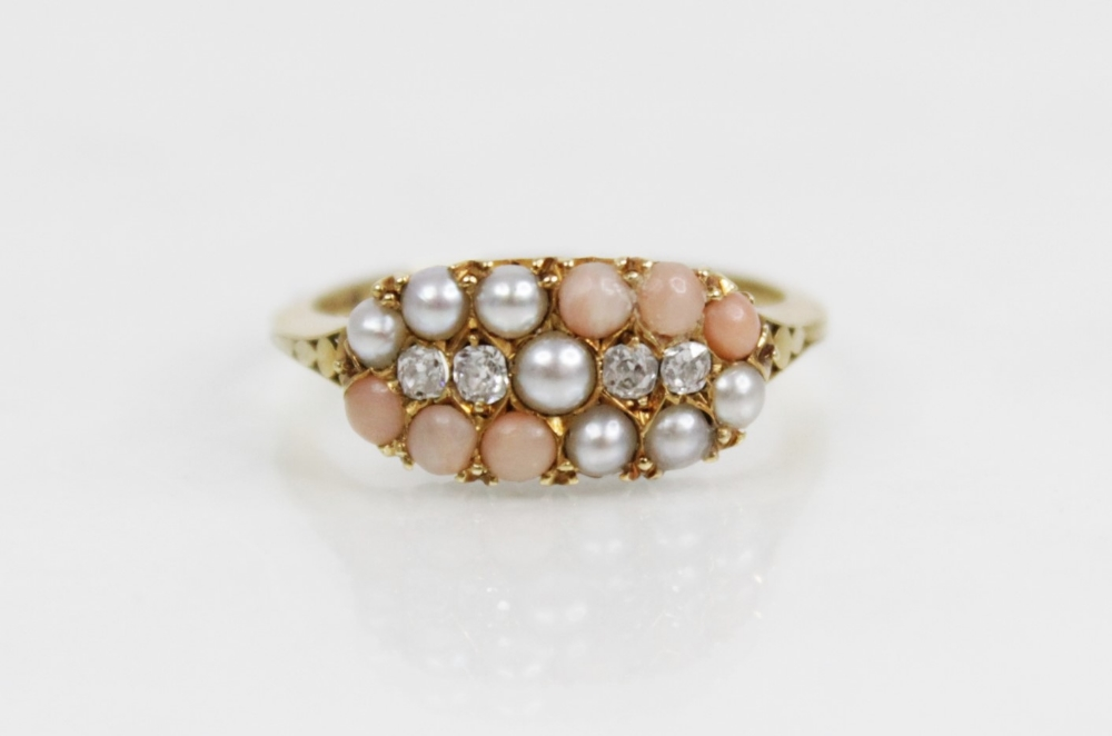 A Victorian diamond, pearl and coral ring, the navette shaped head comprising four old cut