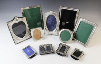 A silver mounted photograph frame by Keyford Frames Ltd, London 1987, of shaped rectangular form