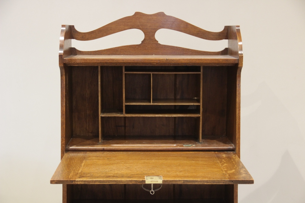 An early 20th century oak Arts and Crafts Glasgow school students bureau, the open work galleried - Image 2 of 3