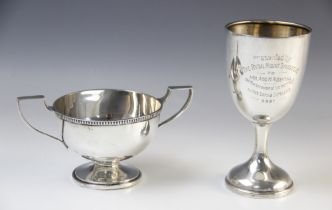 A twin-handled silver trophy cup Walker & Hall, Sheffield 1960, of circular form with cast rim and