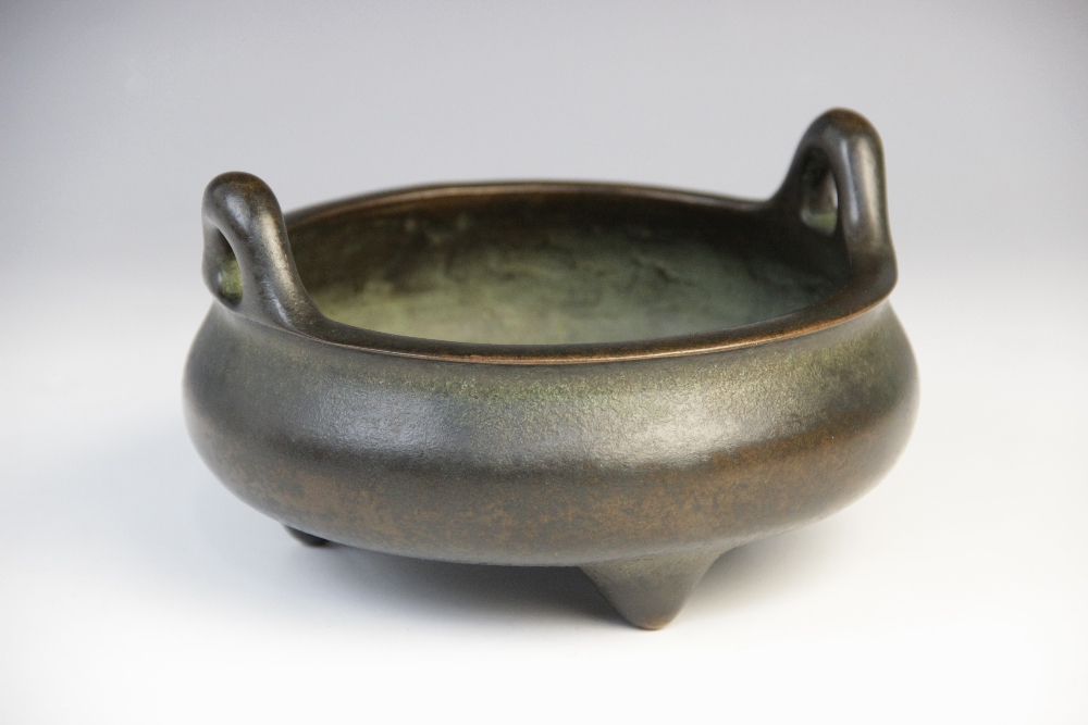 A Chinese bronze censer, of squat bulbous form with loop handles raised on three tapered feet, - Image 2 of 3
