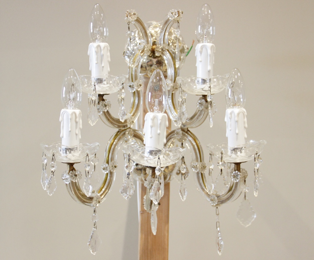 A French glass and gilt metal five branch wall light fitting, the twin dish shaped brackets