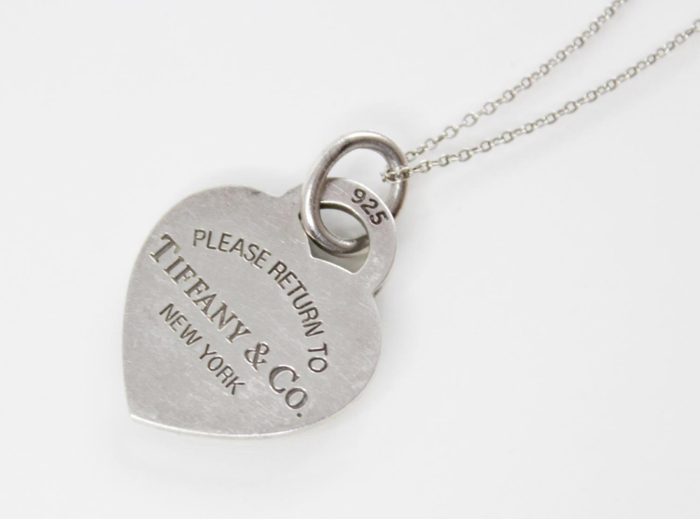 A Tiffany & Co silver heart pendant marked 'Please return to Tiffany & Co. New York', 26mm x 21mm,