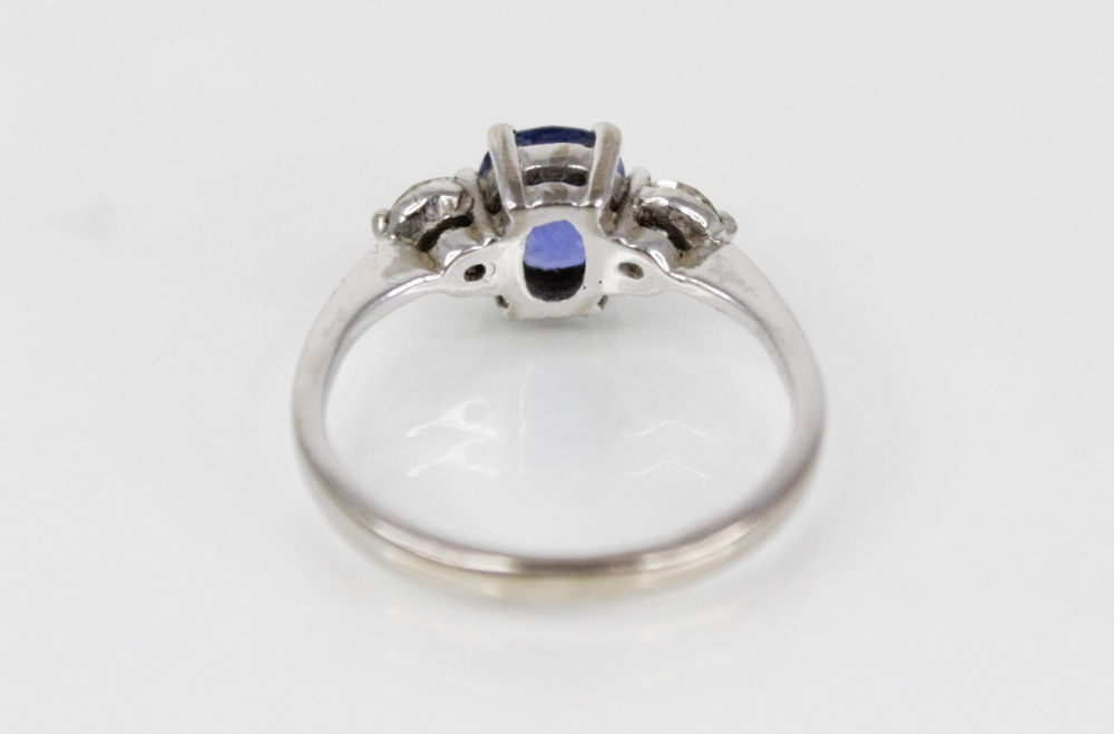 A sapphire and diamond three-stone ring, the (untested) central mixed, cushion cut sapphire ( - Image 6 of 8