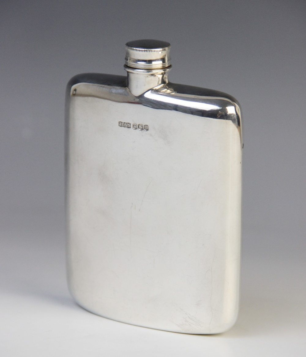 A silver hip flask by James Dixon & Sons, Birmingham 1969, of rounded rectangular form with screw