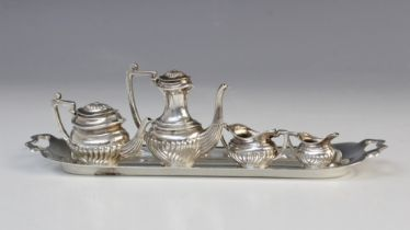 A miniature silver tea and coffee service by A Marston & Co, Birmingham 1973, comprising teapot, 3cm