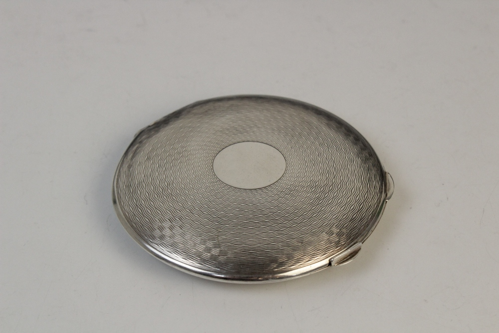 A silver compact by Clark & Sewell, Chester 1942, 7.7cm diameter, together with a silver and - Image 9 of 10