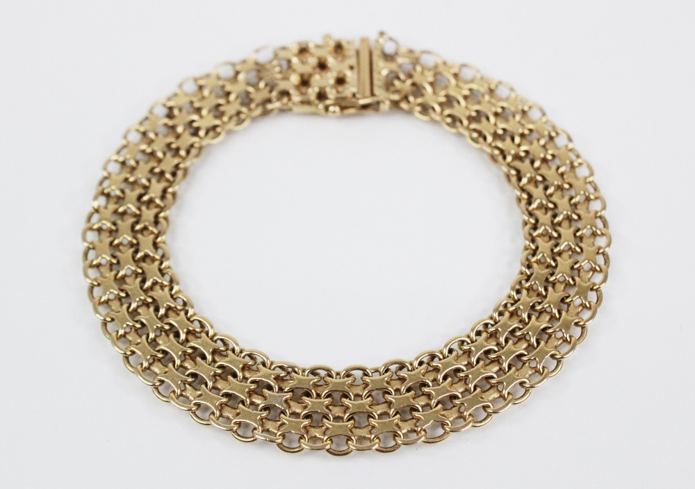A gold coloured woven-link bracelet, with tongue and box snap clasp fastening, stamped '18K' and ' - Image 4 of 4