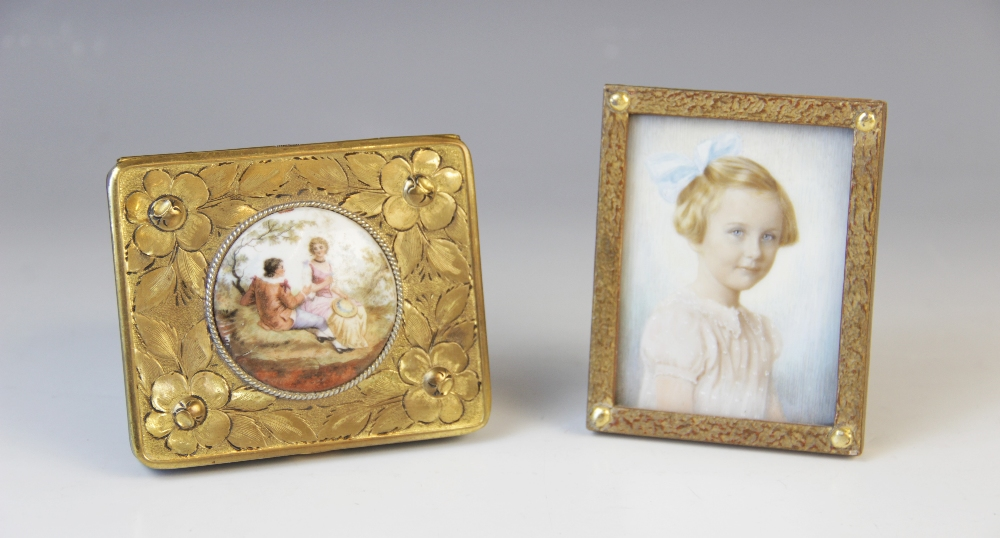 An Edwardian watercolour on ivory portrait miniature, early 20th century, depicting a young girl