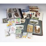A collection of postcards to three albums and a box, early 20th century and later, to include