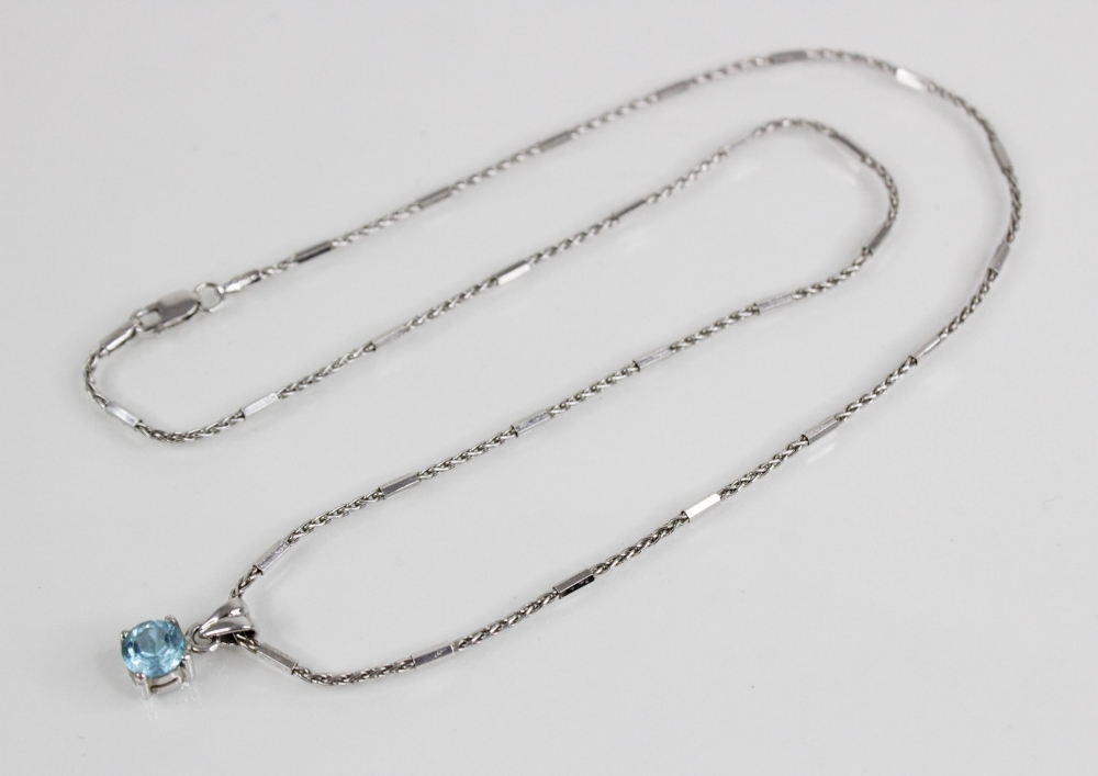 A blue topaz pendant on 18ct gold chain, the central round mixed cut blue topaz (measuring 6mm - Image 3 of 3