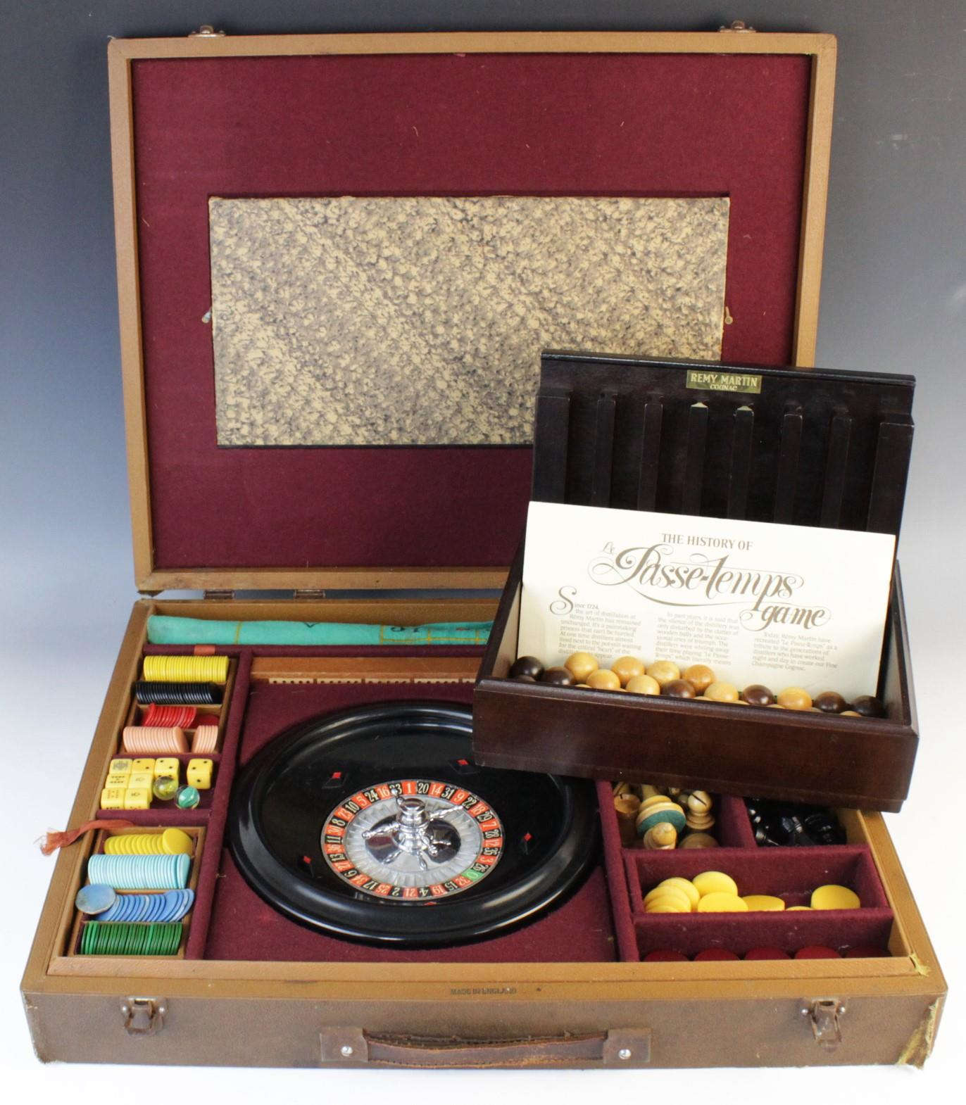 A 20th century cased gaming compendium, contained a Roulette wheel, counters and chess pieces,