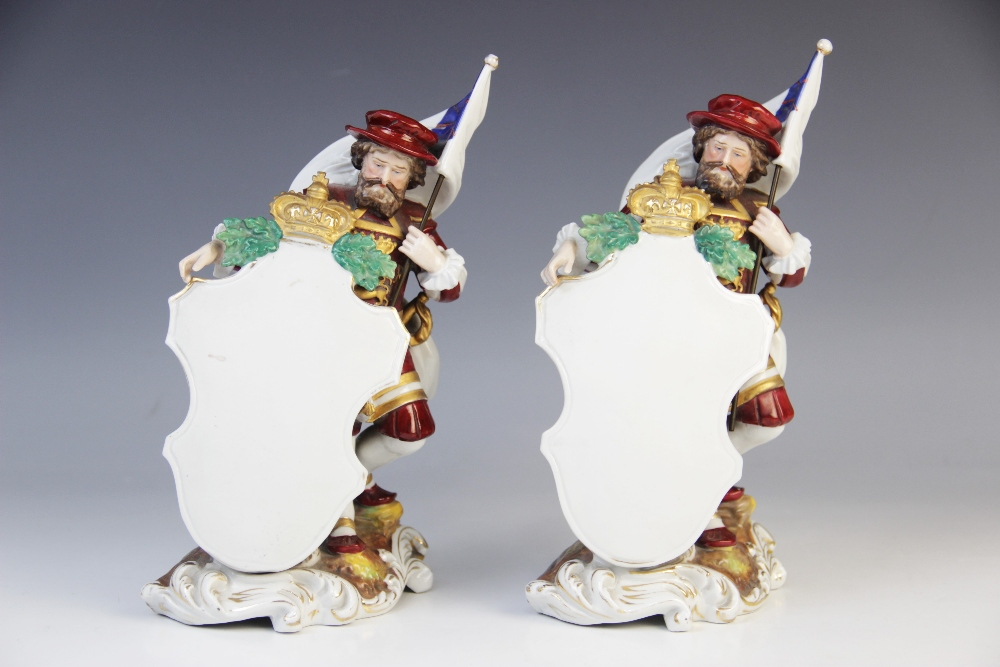 A pair of Dresden porcelain menu plaques, early 20th century, each modelled as a Beefeater