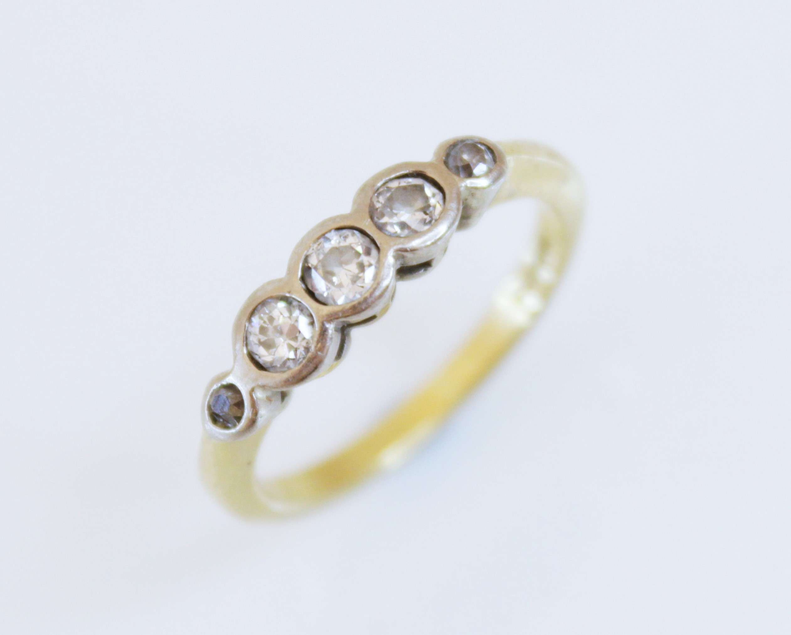 A diamond five-stone ring, comprising five old cut diamonds (estimated total diamond weight of 0. - Image 2 of 2