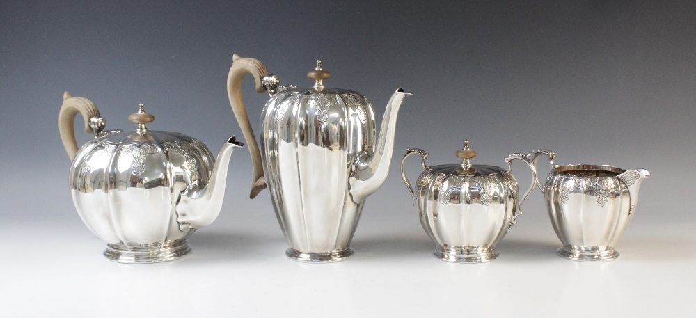 A four-piece silver tea service by Mappin & Webb, Sheffield 1975, comprising teapot, hot water