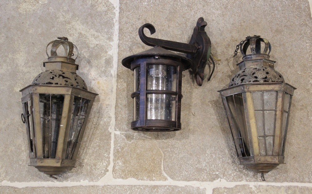 A pair of brass hanging lantern candle holders, of tapering hexagonal form, each with an openwork