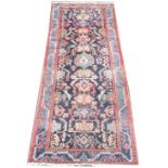 A Persian wool runner, the central panel with a mirrored design of geometric gulls and stylised