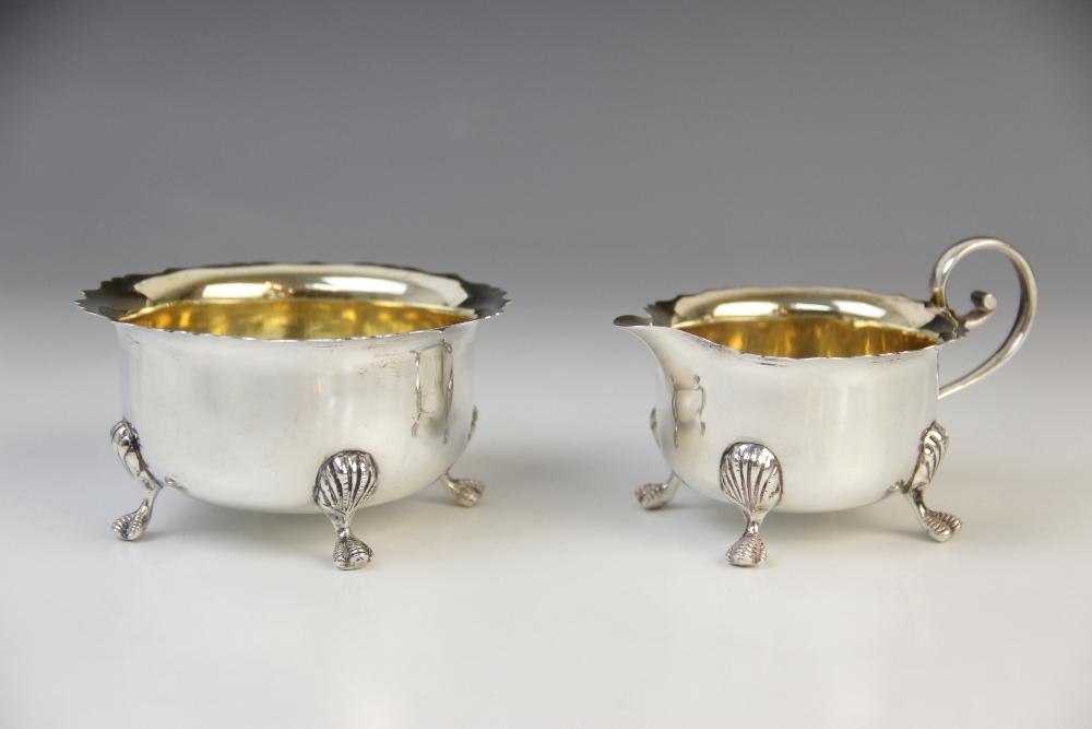 An Edwardian silver sugar bowl and milk jug by J Sherwood & Sons, Birmingham 1904, each of