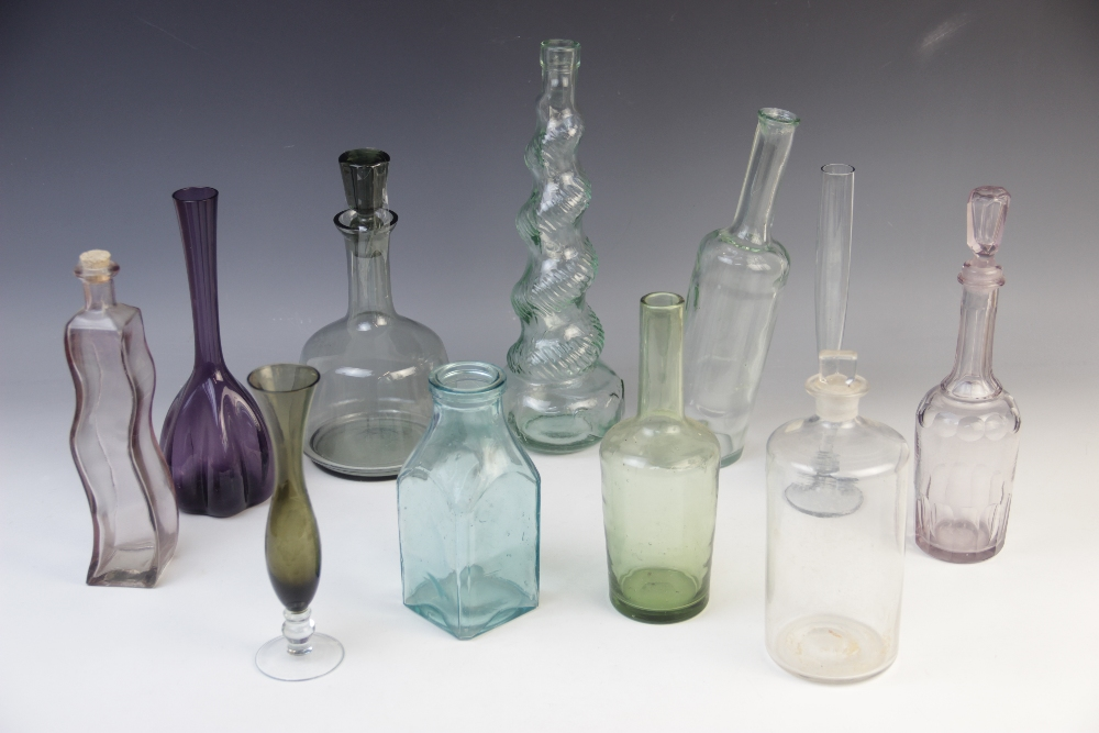 A collection of bottles, decanters and other tall vessels, 20th century 19th century and later, to