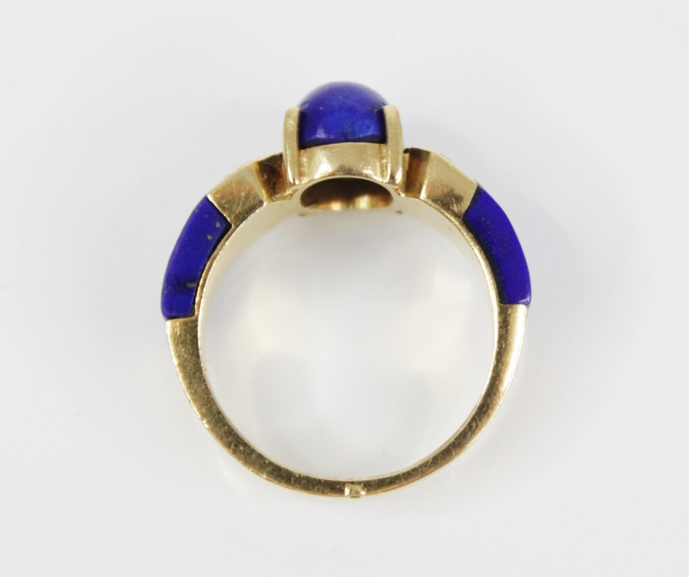 A lapis lazuli and diamond set dress ring, designed as a central polished oval lapis lazuli cabochon - Image 6 of 6