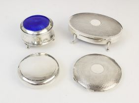 A silver compact by Clark & Sewell, Chester 1942, 7.7cm diameter, together with a silver and