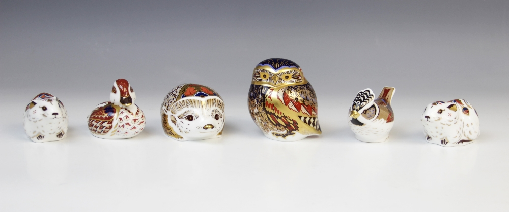 Six Royal Crown Derby paperweights, comprising: two Collector's Guild bank voles (gold stoppers),