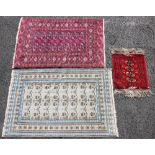 A Bokhara style rug, the sixteen geometric gulls upon a burgundy ground, 142cm x 94cm, along with