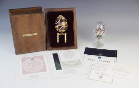 A Frankin Mint 1984 House of Igor Carl Faberge Imperial Anniversary Egg, the silver egg with