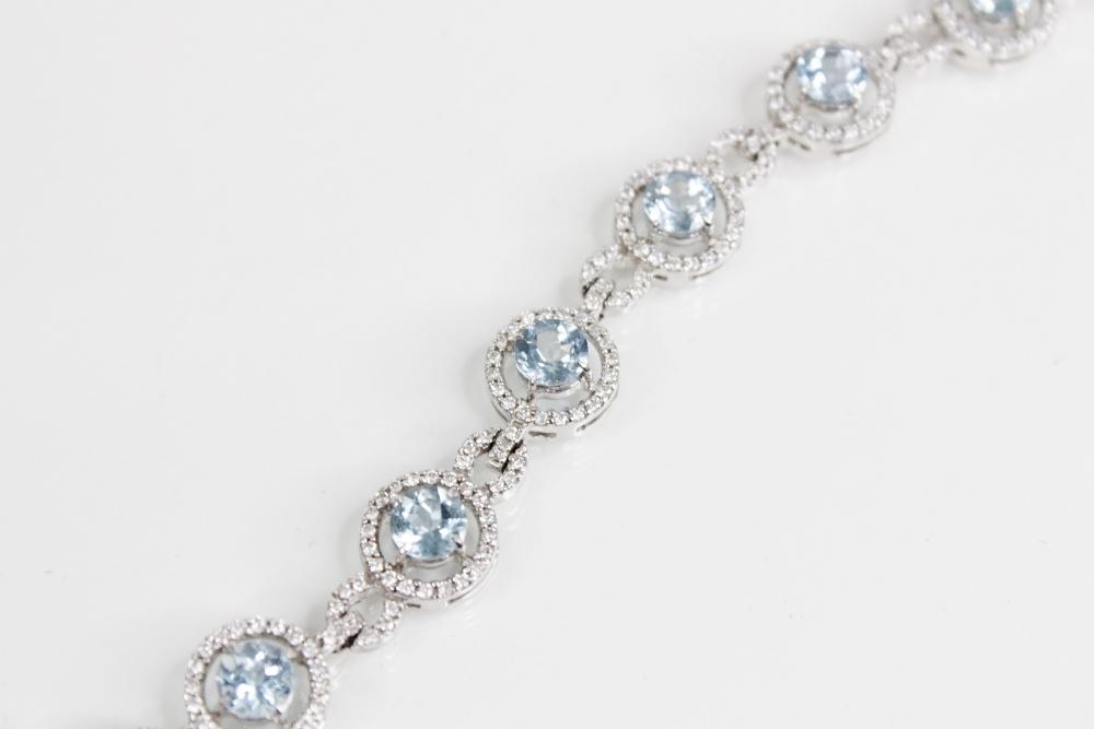 An aquamarine and diamond bracelet, comprising twelve round mixed cut aquamarines, (each 5mm - Image 2 of 4