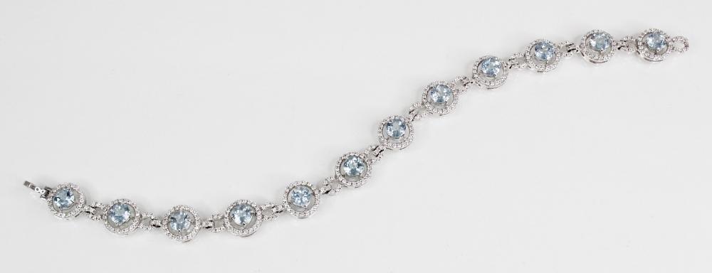 An aquamarine and diamond bracelet, comprising twelve round mixed cut aquamarines, (each 5mm
