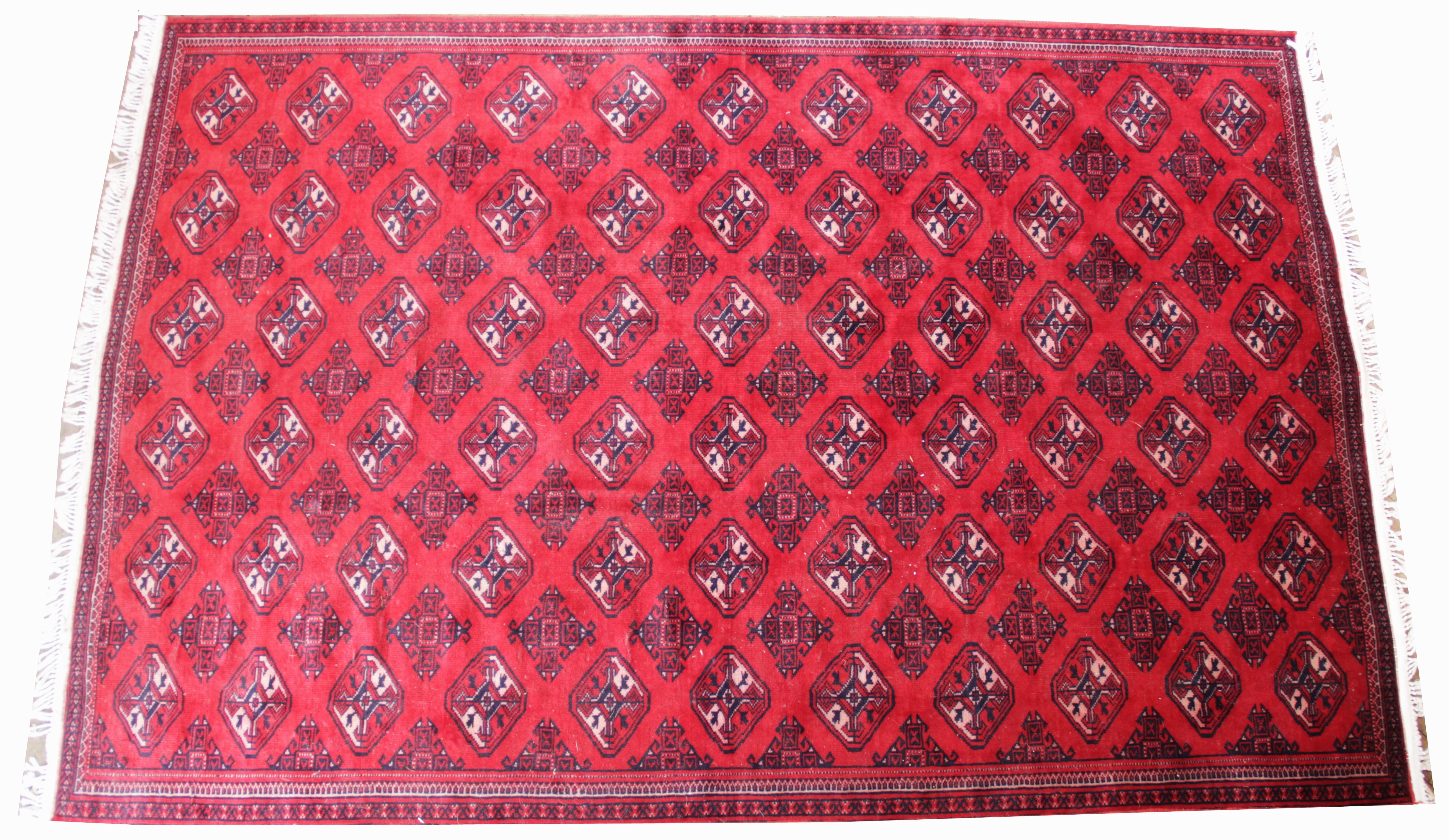 A rich red ground Turkmen carpet, with all over Bokhara design, 270cm x 180cm