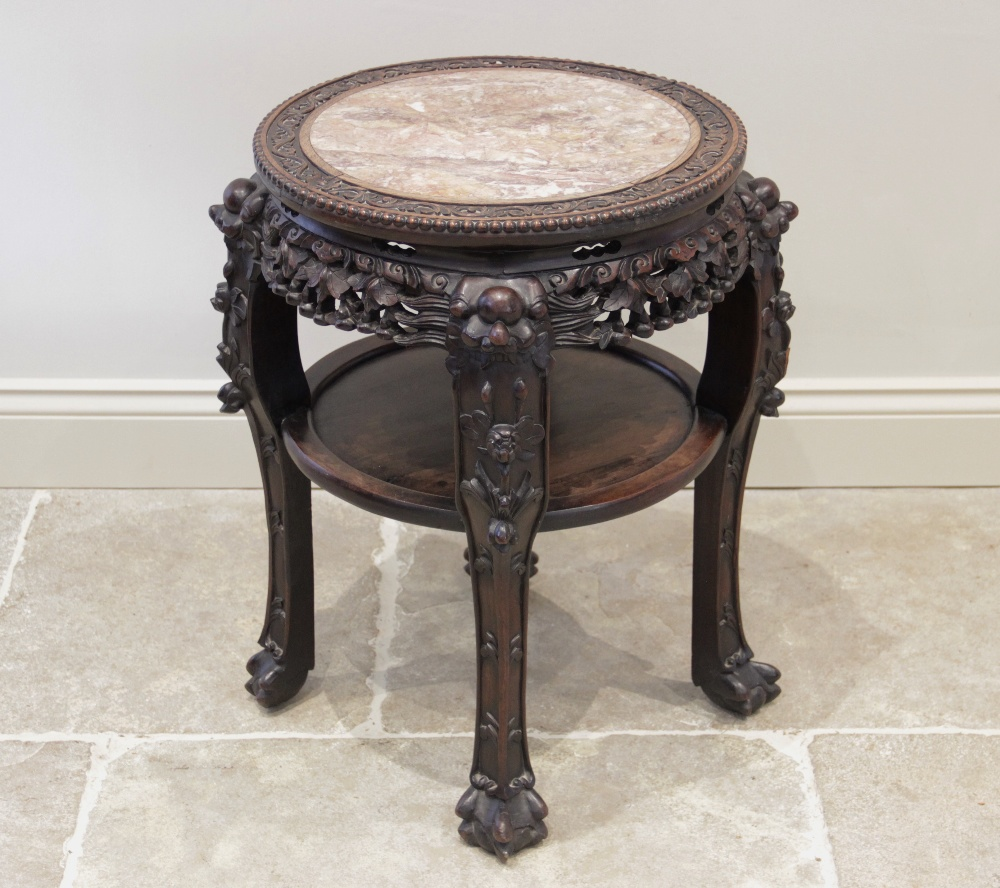 A Chinese hardwood and marble urn stand, late 19th/early 20th century, the circular top with a rouge