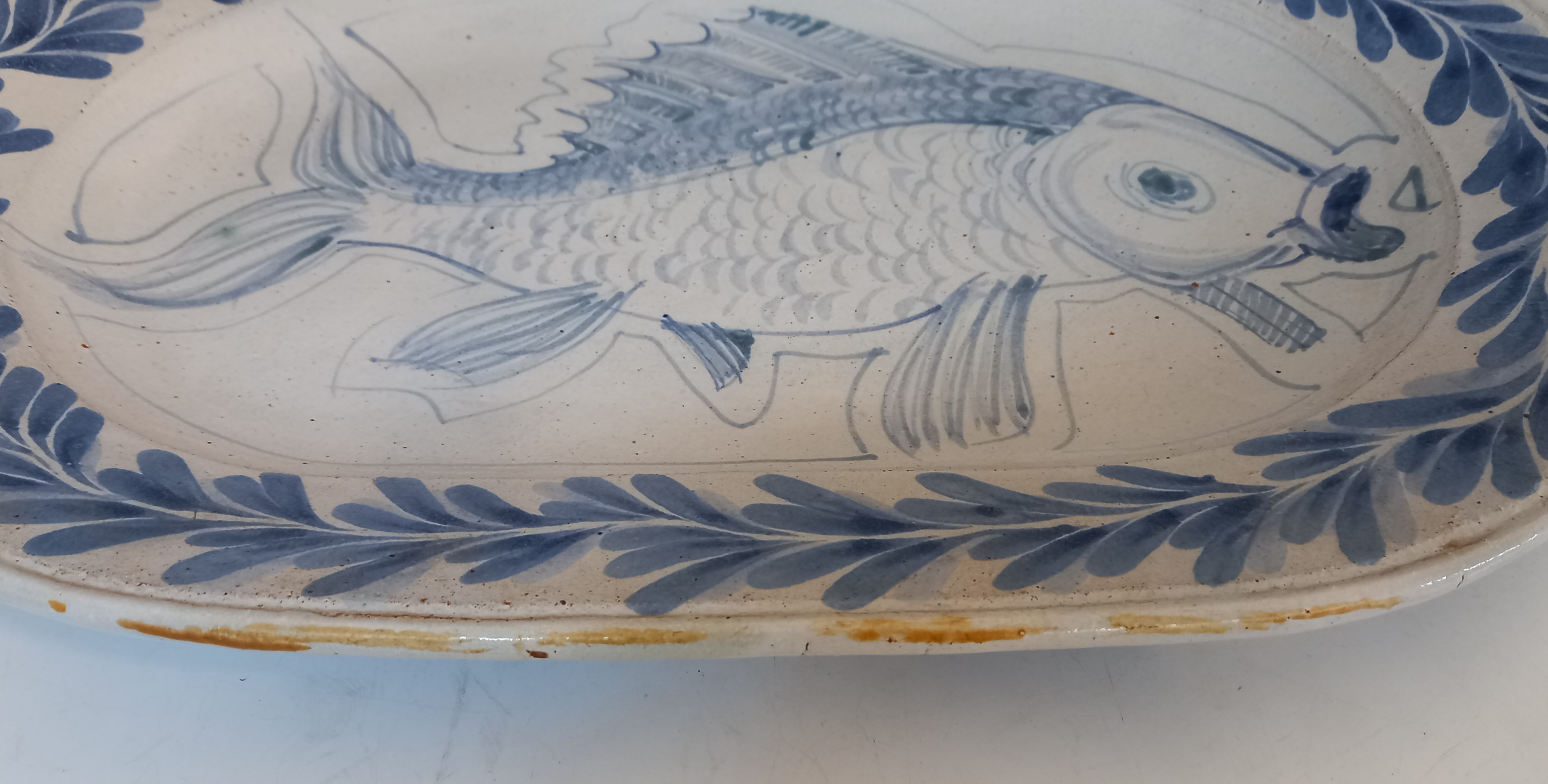 A Cooper Pottery studio pottery fish plate, of oval form, applied with a central blue fish on a - Image 3 of 3