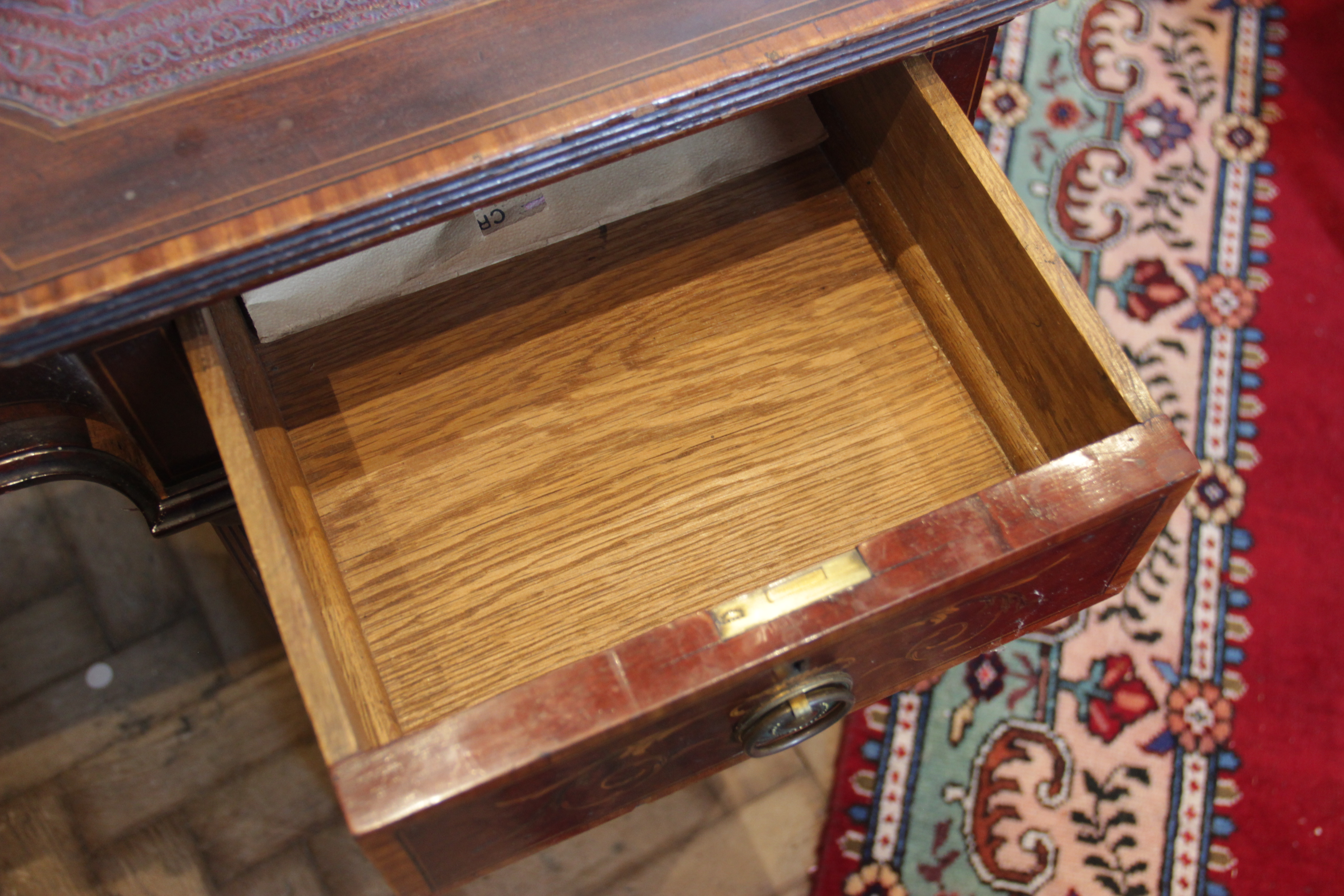 A late 19th century inlaid mahogany twin pedestal writing desk, the inverted breakfront top with a - Image 6 of 7