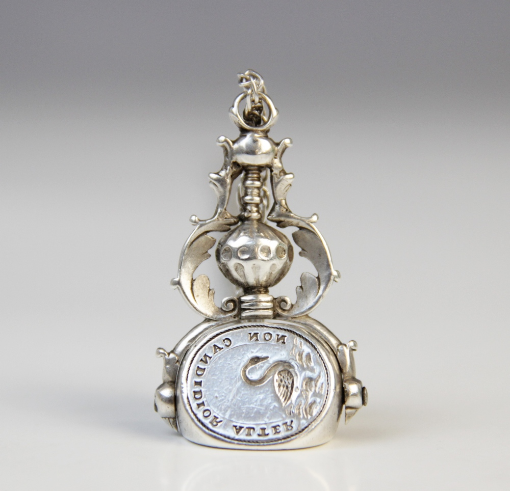 A 19th century silver coloured three-sided swivel fob pendant, each oval face with an engraved - Image 3 of 3