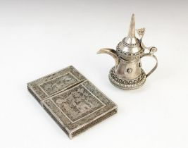 An Indian silver coloured wirework card case, of rectangular form with detachable cover, the central